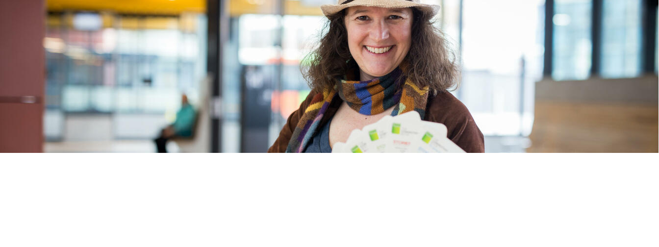 Magdalena Lorenzo with Commuting Books QR stickers. Photo by Erica Austin, Peanut Productions Photography