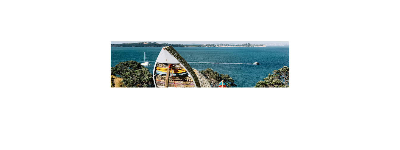 'Journey Of A Million Miles Begins with One Step' by Tiffany Singh for Headland Sculpture on the Gulf 2016, Waiheke Island, NZ. Materials used are upcycled dinghies and fabrics with audio stories from the resettled community in partnership with Aotearoa Resettled Community Coalition. Image by Pete Rees.