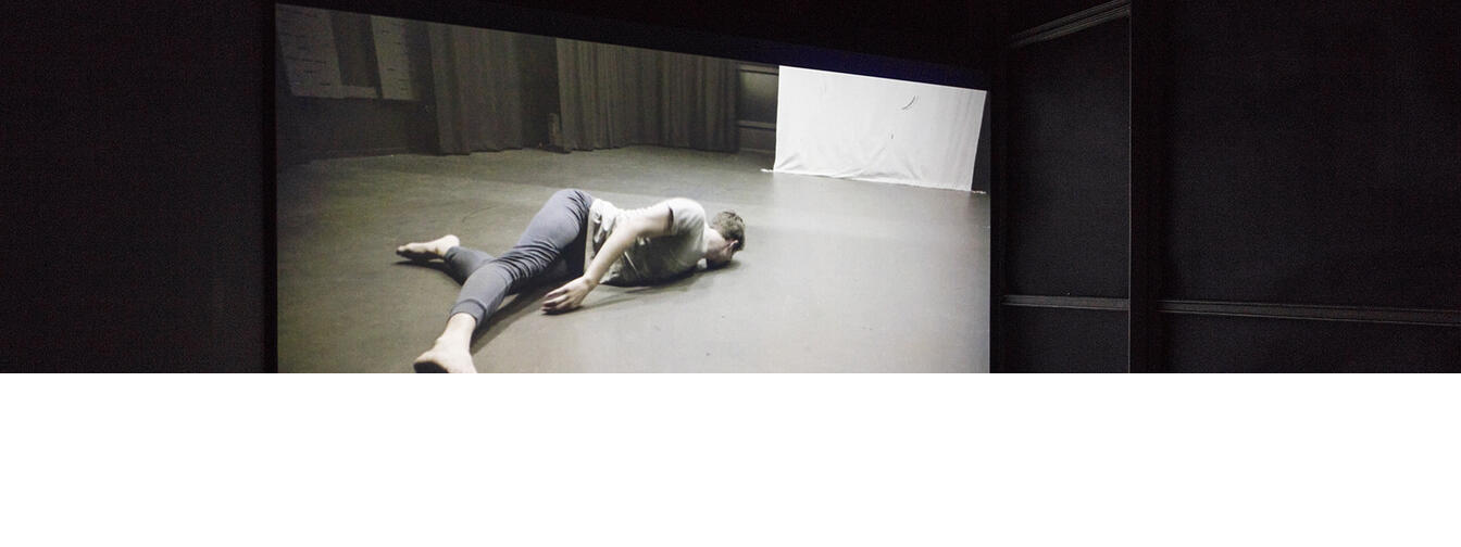 Installation view of Sriwhana Spong, The Fourth Notebook, 2015, HD video, 8 mins, 36 secs. Courtesy of Michael Lett, Auckland. Dancer: Benjamin Ord. Commissioned by Carriageworks, Sydney. In the exhibition Inhabiting Space at the Adam Art Gallery Te Pātaka Toi, Victoria University of Wellington. Photo / Shaun Waugh.