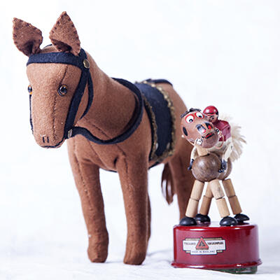 Maud Jackson, Toy Horse, 1940s, felt. Line Bros, Push button horse and jockey, 1950s, tin and wood.