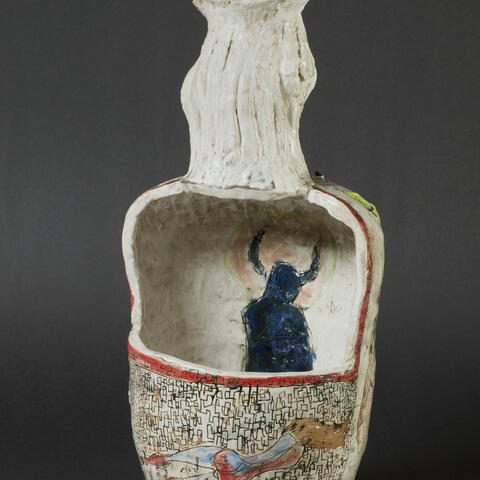 House of Dee, by Oliver Morse. This image of the winning work shows a cut-away vase, with inscribed drawings and a bent neck.