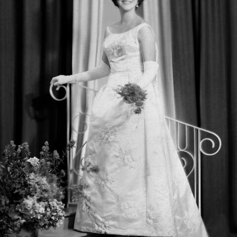 Gay Phelps is a Wairarapa-born beauty queen, who left the district to study in Auckland. While there in 1965 she became Miss New Zealand, her winning dress being a stunning red gown and cape, now in the New Zealand Museum of Fashion.  She spent the next year wearing a woollen wardrobe, helping promote the Woolmark brand. She returned to Wairarapa to marry Tom Williams of 'Te Parae' in 1968, and together they raised three children, and countless sheep, cattle, horses and deer.