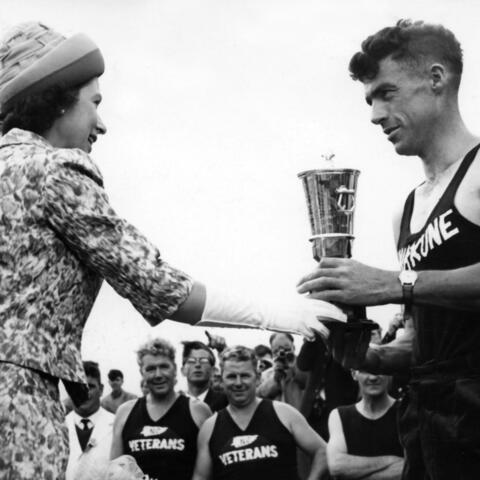"""Allan Williamson won the Royal Invitational Golden Shears in Lower Hutt in 1963. Unfortunately, he was drying himself off when he was called to receive his trophy from the Queen and did not hear his name being called. When he rushed to the stage to be presented with his trophy the Queen said: """"Mr Williamson, you are the first man in the world to keep me waiting""""."""