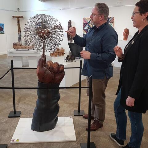 Richard Benge and Kerence Stephen of the Taupō Museum admire Blown to the Wind