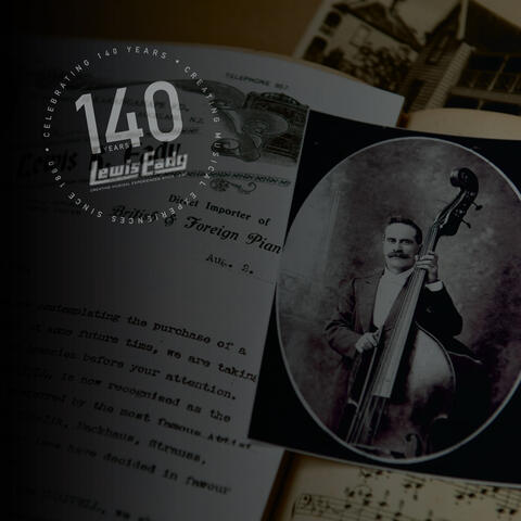 Old document next to an old photograph of Lewis R Eady holding a double bass. Lewis Eady 140th Anniversary round logo on top left corner.