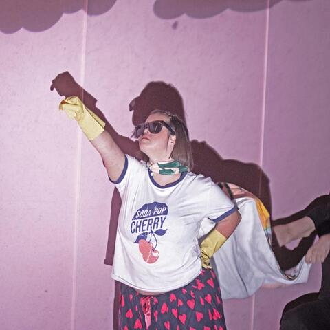 Lily Harper's character Mattie doing a superhero pose in Up Down Girl