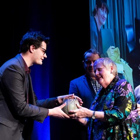 Robyn Hunt presents the award to Circa's Accessibility Manager James Cain