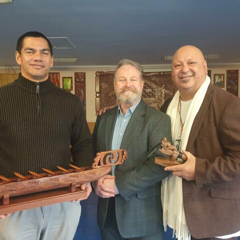 Lawrence Ereatara and Hone Fletcher with Richard Benge, Arts Access Aotearoa, when he collected the two carved trophies for the Arts in Corrections awards 2021