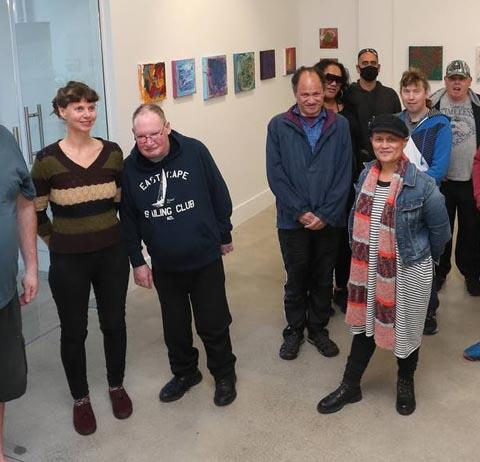 A group of artists at the opening of an exhibition at the Edith Gallery