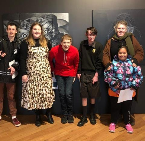 Kelsey Hankins with a group of four students from Kowhai Specialist School