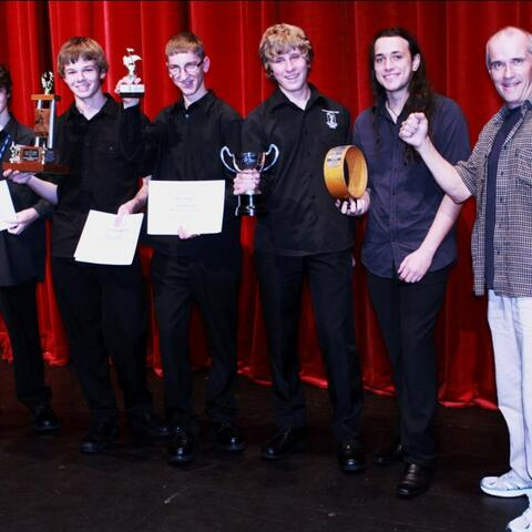 Tauranga Boys' College Combo celebrate their win. Left to right: Edward Linton, Kelly Ballard, Eric Begley, Todd Herbert and Milan Wilshire with band director Murray Mason