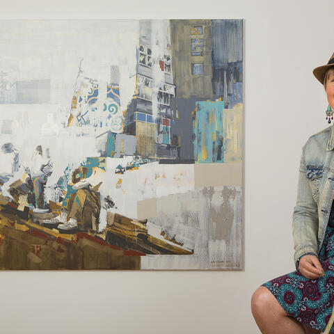 Artist Lisa Chandler with the painting 'No Man Can Do More Than He Can'