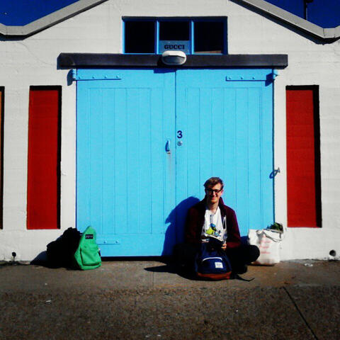Tom du Chatenier leaning against a Wellington boatshed