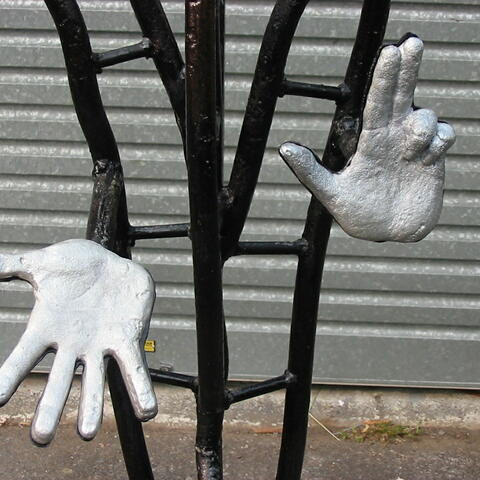 sculpture detail,hands in cast aliuminium ,rest welded steel