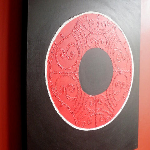 Circular painting using maori design elements