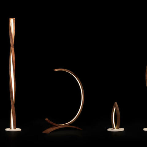 Modern light sculptures made out of single piece of bent wood. hand crafted out of 200 years old New Zealand black walnut. With energy efficient LED.