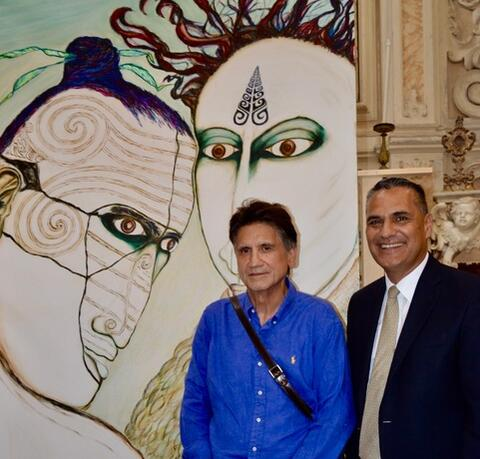 Joseph and NZ Ambassador to Italy, Patrick Rata in front of Joseph's painting Hinemoa and Tutanekai in Matera Italy. Image: Arte Italia Taukoko Māori Association
