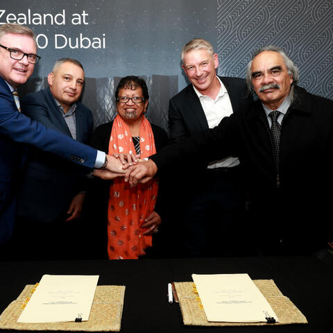 Photo: Photograph at signing ceremony (left to right): New Zealand's Commissioner-General to Expo 2020 Clayton Kimpton; Ngā Tāngata Tiaki o Whanganui Chair Gerrard Albert; Te Urumanao Gardiner; NZTE CEO and New Zealand at Expo 2020 Steering Group Chair Peter Chrisp; Ngā Tāngata Tiaki o Whanganui Trustee, Joey Allen.