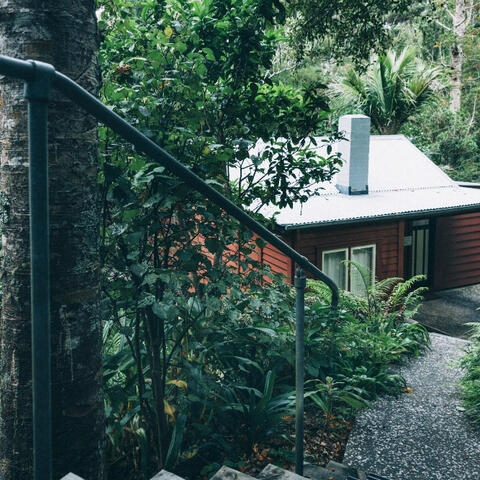 Caption: McCahon House Museum in Titirangi's French Bay a vibrant example of NZ vernacular architecture.