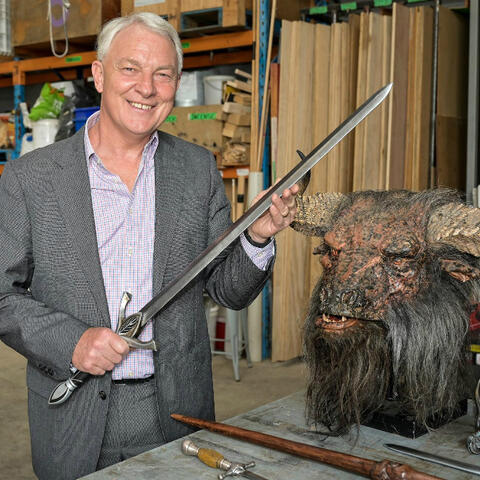 Auckland mayor Phil Goff with sword at the announcement of a new screen mentorship programme at FilmFX.
