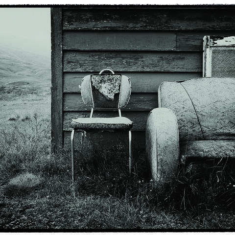 Photos by Jackie Ranken and Mike Langford show differing perspectives on an abandoned couch in New Zealand's high country.