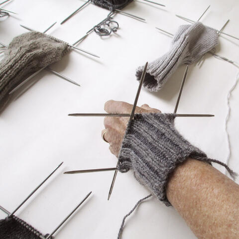 Vivien Atkinson, Knitting (detail), armbands, vintage knitting needles, scraps of wool thread, 2019. Image courtesy CODA Museum.