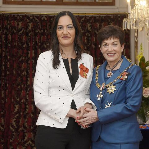 Briar Grace-Smith (left), after her investiture as ONZM, for services to theatre, film and television, by the Governor-General, Dame Patsy Reddy in 2018.