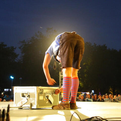 A performer onstage in Hagley Park for the 2012 World Buskers Festival - the first held since the Christchurch earthquake. Photo: Supplied/Jodi Wright.