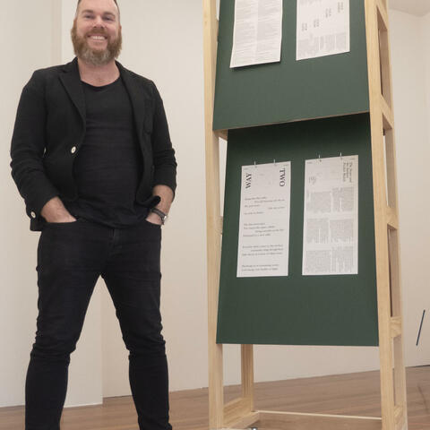 The Physics Room director Jamie Hanton with a work by Daniel Shaskey, part of the gallery's current Domino Domino exhibition. Photo: Nigel Malthus