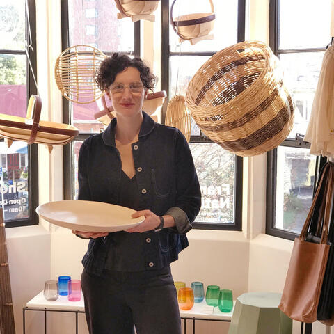 Tessa Peach with a ceramic platter in her Frances Nation Shop in the Christchurch Arts Centre. Photo Supplied/Tessa Peach.