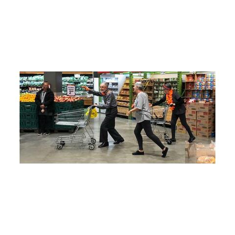 A group of dancers performing in a supermarket