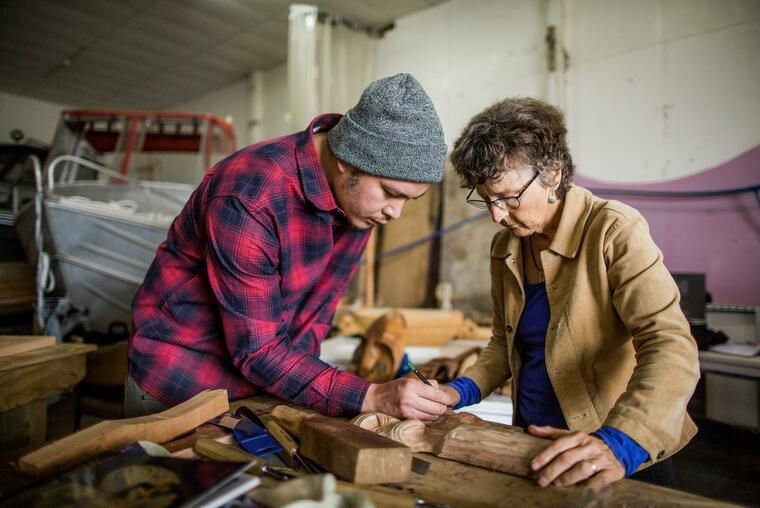Student and teacher working on a carving. Image: supplied